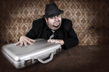 Business man and his suitcase