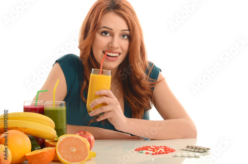 Woman choosing between pills and an organic smoothie