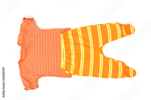 Close up of a baby red t-shirt and orange striped pants isolated