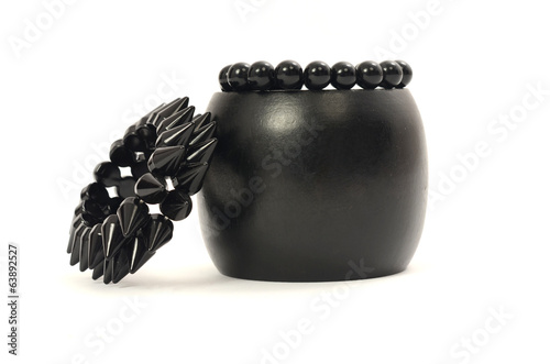 Close up on a three black bracelets, bracelet with spikes