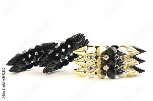 Close up on a three black bracelets with spikes