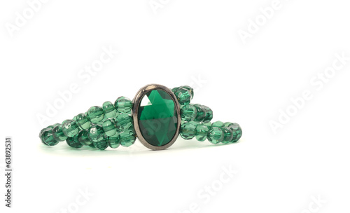 Close up with a green necklace isolated