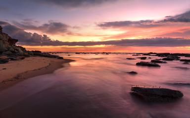Magnificent sunrise high tide at Bateau Bay rockshelf