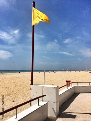 Yellow flag in the beach