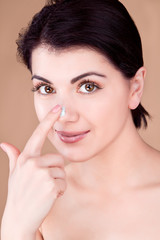 girl with cream on her finger touching the nose, Pinocchio