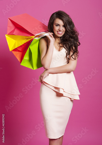 Elegant and smiling woman with shopping bags