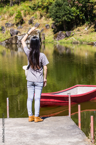 Asia woman With Ship in Lagoon