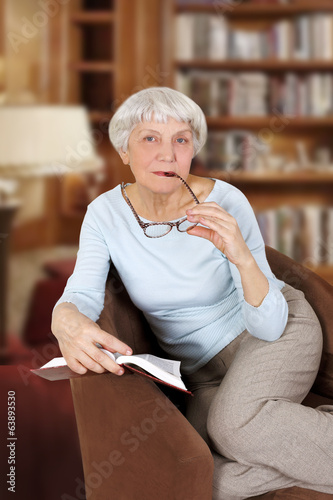 elderly woman with book and glasses sitting in a chair, mother,