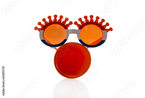 orange glasses and horn