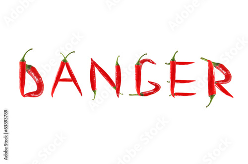 Picture of the words DANGER written with red chili peppers