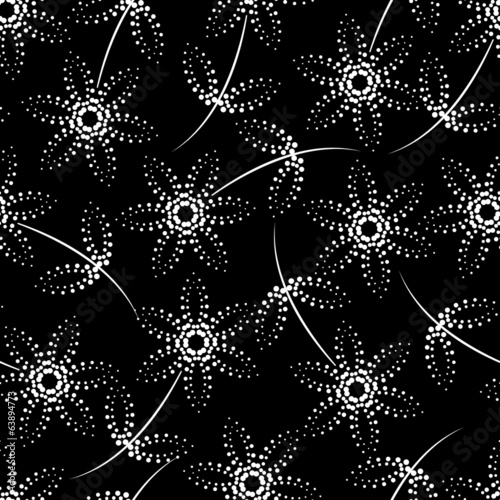 Seamless black and white dot pattern with flowers and leaves