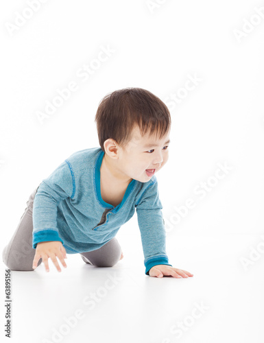 cute baby boy is crawling on floor