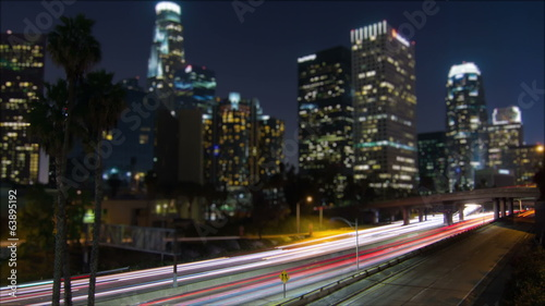 Night Traffic Time Lapse of Busy Freeway In City