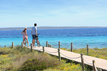 Couple riding bikes on Formentera Island