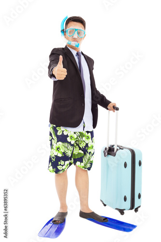 amusing businessman wore scuba gearing and thumb up