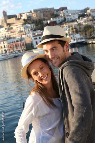 Couple of tourists standing on the port of Ibiza
