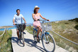 Couple riding bicycles in summertime