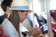 Tourist girl connected on smartphone in ferry boat