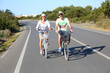 Couple having fun riding bicycles