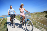 Couple riding bicycles in summertime - Fine Art prints