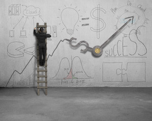 Man drawing business concept doodles on wall