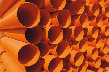 Orange pvc pipe sections.