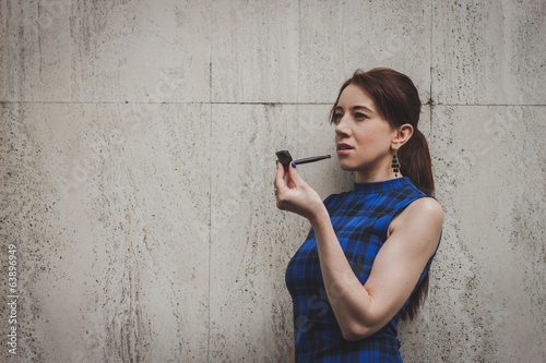Pretty girl smoking vintage pipe