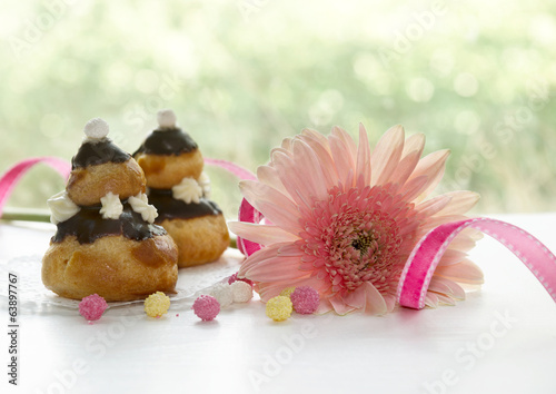 Sweets with gerbera on table