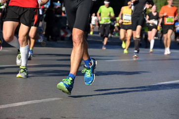 Marathon running race, people feet on road