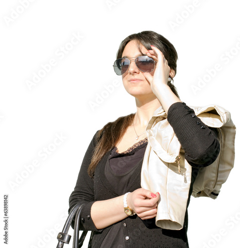 YOUNG FASHION GIRL AGAINST WHITE BACKGROUND