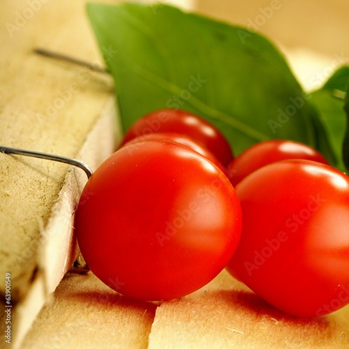 tomatoes and basil on a broken wooden box