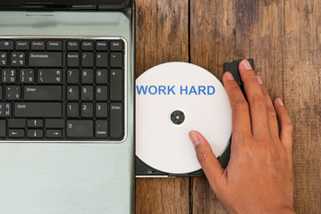 Work hard  concept laptop with compact disk