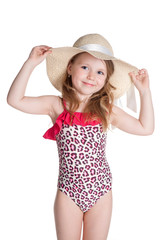little blonde happy girl in pink swimsuit holding hat