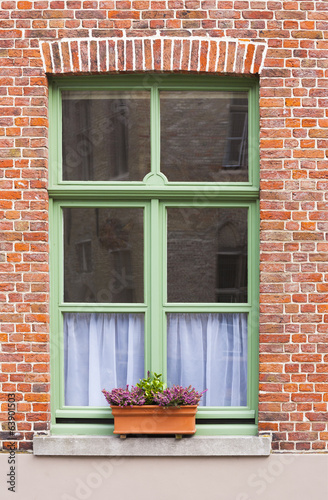 Traditional brick house window with window box