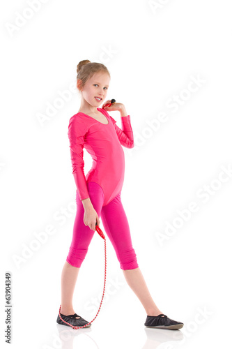 Little gymnastics girl posing with skipping-rope