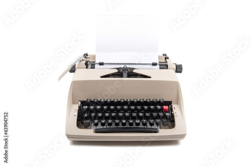 Typewriter with paper isolated on white background