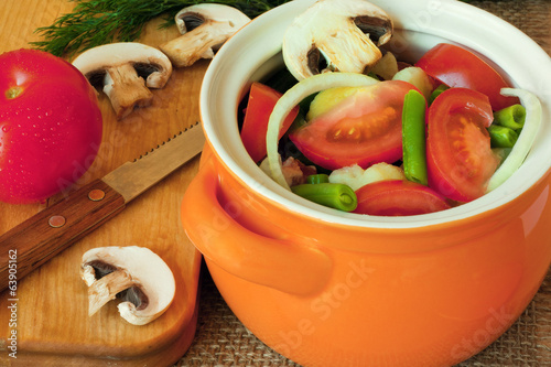 Different vegetables in a clay pot