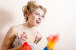 funny young pinup woman clean up, removing dust