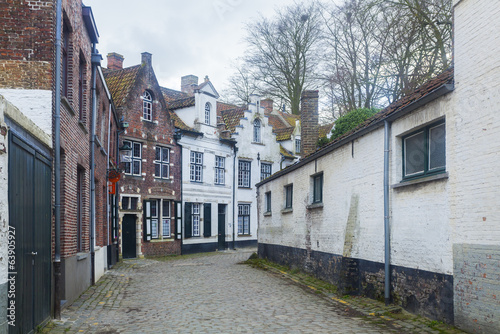 Traditional buildings and cobbled street Bruges, Belgium