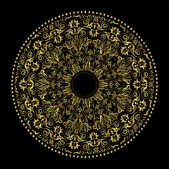 Golden plate with vintage ornament on black background