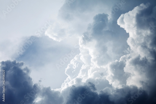 Dramatic sky with stormy clouds - 63906525