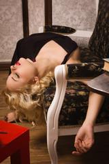 Lifeless woman in a luxurious interior