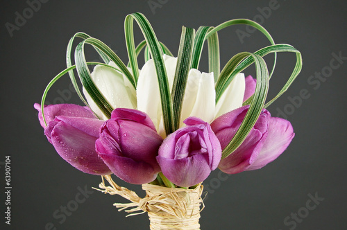 Beautiful bouquet with white and purple tulips