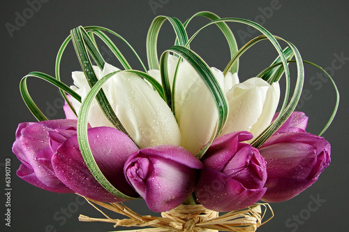 Bouquet with white and purple tulips close up