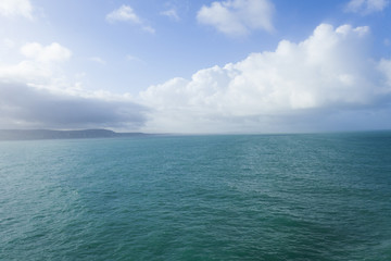 Sea view leaving Dover, with blue sky and clouds