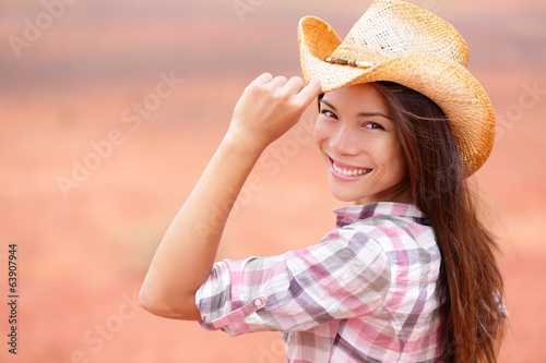Cowgirl woman smiling happy on american prairie