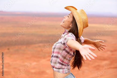 Cowgirl - woman happy and free on american prairie