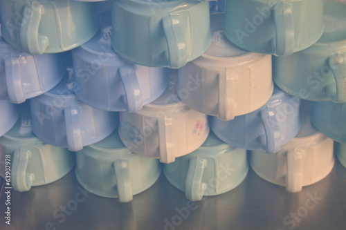 cups for tea piled on table
