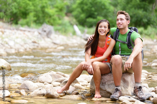 Hiking couple - hikers resting in Zion Park