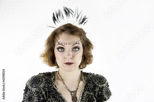 Beautiful young woman dressed as flapper in sequin dress